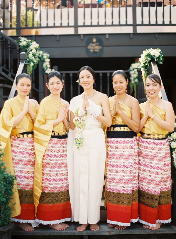 Beautiful bridesmaids with the stunning bride at this multicultural Scottish and Thai wedding held in Chiang Mai, Thailand. Photo by Caroline Tran via JunebugWeddings.com.
