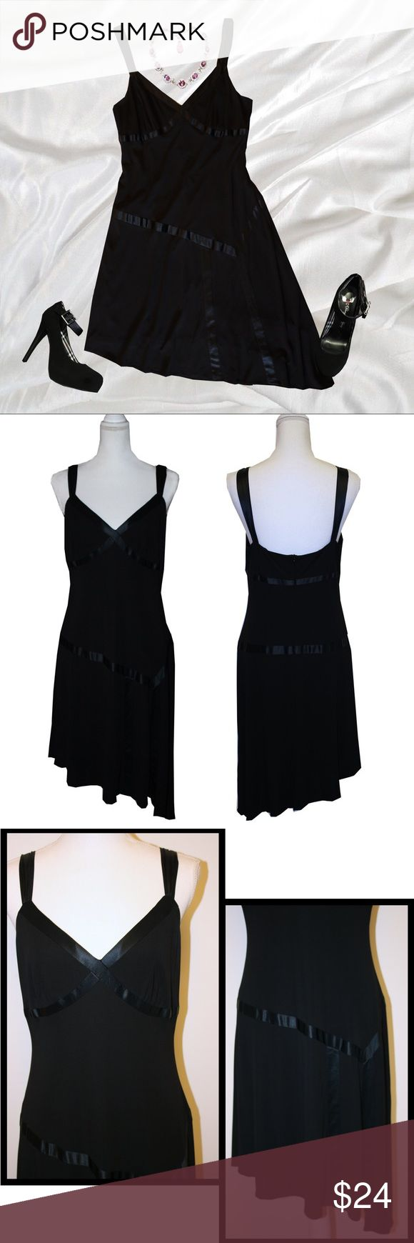 """Plus"" Nine West Black Asymmetrical Hem Dress This is the perfect little black dress!!  * Satiny detail  * Asymmetrical hem  * Fully lined * Back zip * Stretchy  * 72% rayon / 28% Polyester   APPROXIMATE MEASUREMENTS   * Armpit to pit 18"" * Waist 32"" * Hips 39"" * Length short side 38.5"" * Length long side 41.5""  I do not believe this dress has ever been worn. It is in pristine condition and has no signs of wear. It is by Nine West and size 14. Nine West Dresses Asymmetrical"