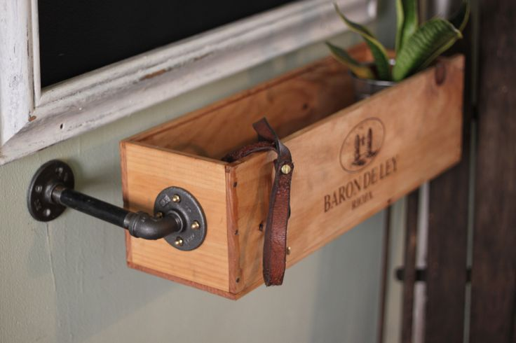 Window box made from a wine box and 1/2″ industrial pipes. It's stained and polyurethaned. pgpostals.com