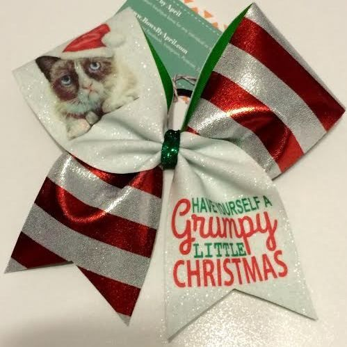Bows by April - Grumpy Cat Have a Grumpy Christmas Red Stripes and White Glitter Cheer Bow, $15.00 (http://www.bowsbyapril.com/grumpy-cat-have-a-grumpy-christmas-red-stripes-and-white-glitter-cheer-bow/)