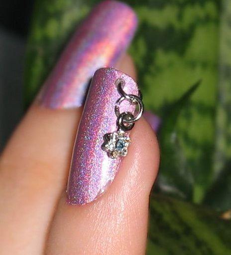 I used to do this in HS, guess its back in style nail piercing #MyFingerNailDesigns