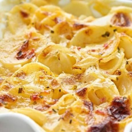 Campbell's Scalloped Potatoes Recipe... add ham or peameal to the recipe. I made it with 75% potatoes & 25% sliced carrots... and 1/3c each milk and water. It was moist and really tasty!!