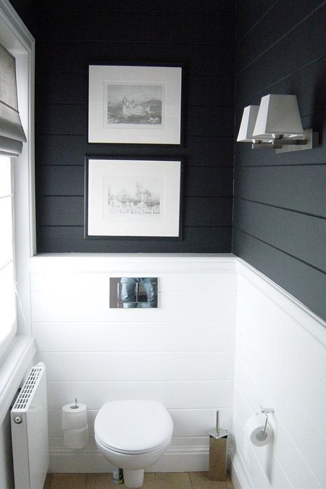 Dark top with white bottom planked bathroom walls