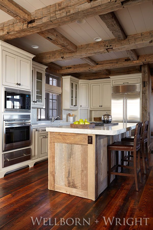 Reclaimed hand-hewn beams on ceiling. Reclaimed hit+miss pine flooring.