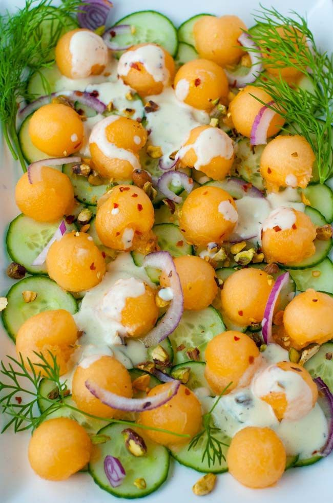 Melon Cucumber Salad with Creamy Greek Yogurt Dill Dressing.This refreshingly sweet salad features Honey Kiss melon balls and crispy cucumbers with a little zing from red onion and chili flakes. Drizzled with a creamy Greek yogurt dressing, it's an ideal summer salad. It's sweet with a little heat! |www.flavourandsavour.com