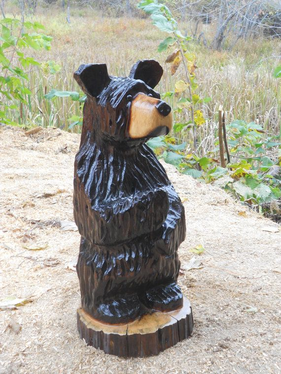 Original chainsaw carved wood black bear hand by
