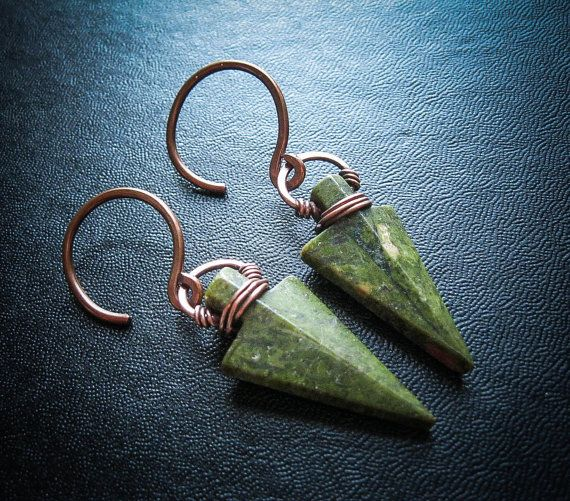 Straight and true, these stone arrowheads are set with a cold forged copper bails inspired by traditional Norse jewellery design and the dwarf smiths of Norse legend. This particular piece is inspired by Davlin, a dwarf mentioned in the Norse Edda, Voluspa. They hang from 1.6mm wide hoop-hooks and will fit through most tunnels or 14g stretched lobes. I can also hang these from niobium ear wires for regular piercings (20g), but I would recommend the wearing be used to heavier earrings! They…