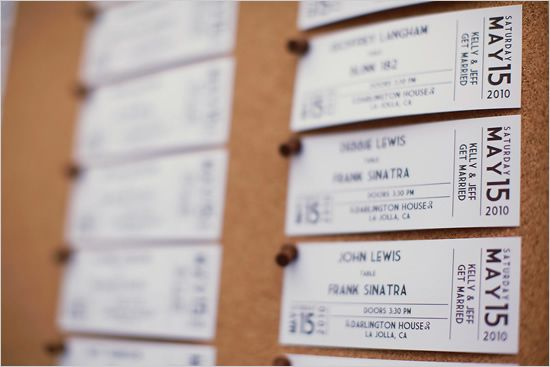 tickets as seating cards for a music themed wedding