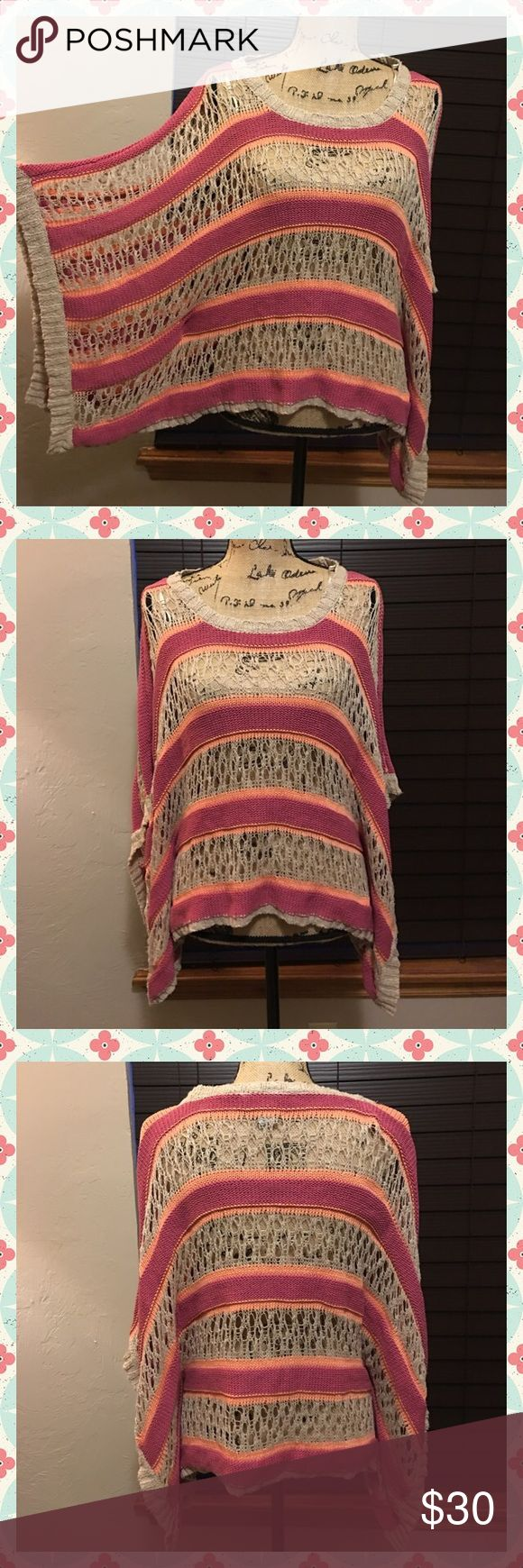 NWOT✨American Rag Pink Striped Poncho✨CUTE!✨ NWOT American Rag Pink and Cream striped poncho! A lovely piece to add to you closet! This was never worn and is NWOT! American Rag Sweaters Shrugs & Ponchos