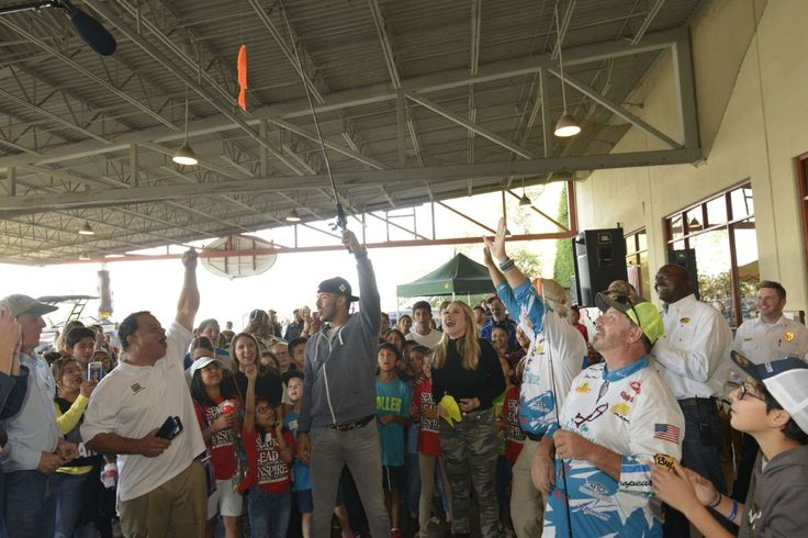 Astros' Carlos Correa, fiancee surprise kids at fishing clinic  -  December 4, 2017.   Houston Astros' World Series champion Carlos Correa and his fiancŽ Daniella Rodriguez in partnership with Vamos A Pescarª share the joy of reeling in a #FirstCatch with over 100 families at Bass Pro Shops Katy on Saturday, Dec. 2, 2017, in Katy, Texas. (Anthony Rathbun/AP Images for Bass Pro Shops)
