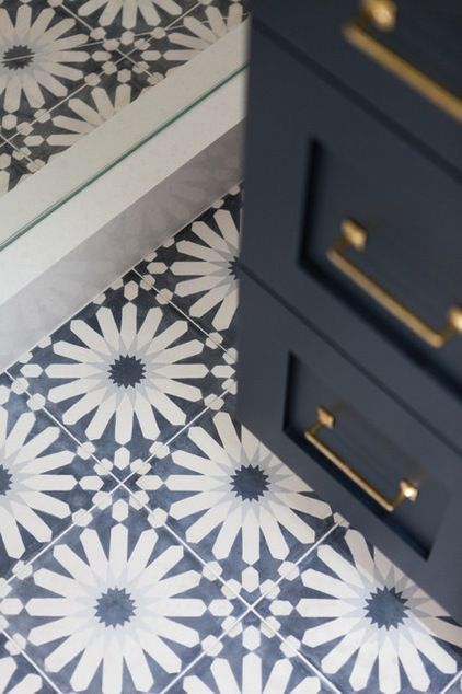 A Mobile Home Gets a Bohemian-Chic Makeover by Becky Harris | Houzz Handmade cement tile on the bathroom floor is a scene-stealer and gives the expected nautical style a big Moroccan twist. Floor tile: Eastern Promise in Tangier Pallazzo, 6¾ by 6¾ inches, by Martin Lawrence Bullard for Ann Sacks . Beach Style Bathroom by Holst Brothers General Contractors