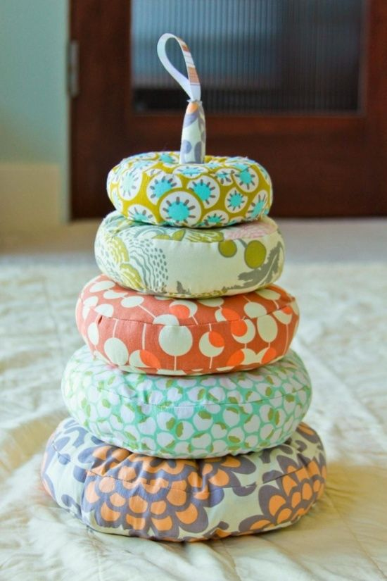 Homemade baby toys... So cute! I need a sewing machine :)