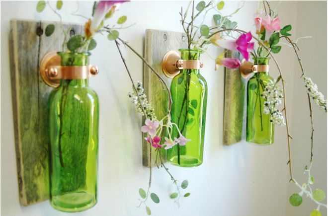 Plenty of bottles could pass for works of art, why not help them? With wood pieces for mounts and some artfully placed flowers, make your old bottles blossom.
