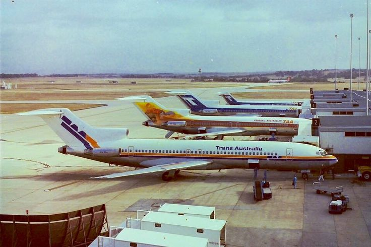 TAA Boeing 727s lined up at Melbourne Airport in the new 80s stylised livery (front), Central Australia livery (centre) and blue T-Jet livery (rear)