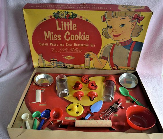 Vintage Wecolite Little Miss Cookie Baking Set Cookie Press and Cake Decorating set From the 1950s to 60s era Complete set comes in original box with 20 pieces Included are 1 plastic mixing spoon, 4 plastic measuring spoons, 1 wood rolling pin, 1 metal egg beater with wood