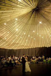 Parachute as ceiling decor. Parachute rental: 35 dollars. Gorgeous!