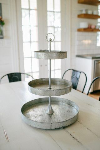 Metal Tiered Stand magnoliahomes.net  need one for the island.. use for serving and decorating..