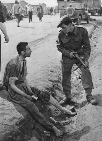 Bergen Belsen, Germany, A British soldier speaking with an inmate, at the time of liberation.