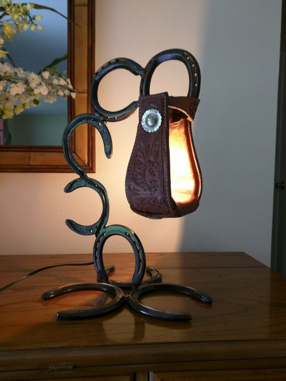Very unique accent lamp made from up-cycled horse shoes and a leather stirrup with a real silver plated decoration. Hand-made and hand