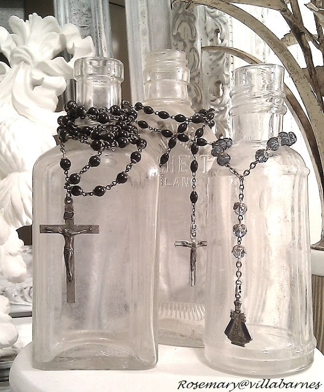 -display rosaries on antique bottles...love this idea.  If not Catholic, you could browse your jewelry box for most any string of beads.