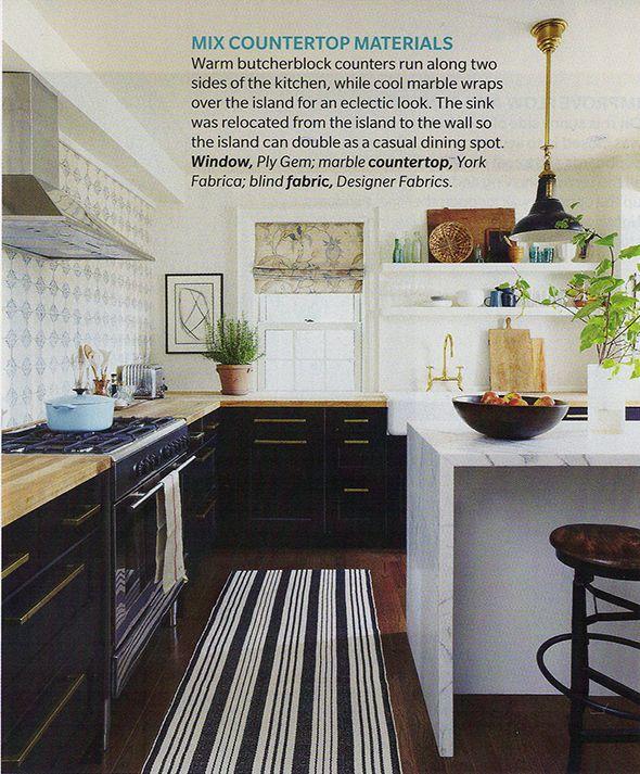 black ikea cabinets, gold hardware, butcher block counters, beautiful tile, marble island