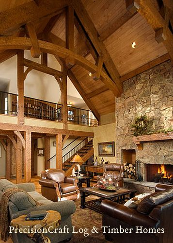 Type of great room I want with the exposed rack and pin wood beams, and loft. Gotta have a stone fireplace too!