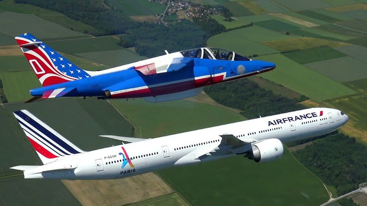 Sporting the colours of France – An Air France Boeing 777 and the Alpha Jets from the Patrouille de France are sporting the colours of France in the sky of La Ferté-Alais. https://wunderflug.com/magazine/sporting-the-colours-of-france_air-france-boeing-777-flies-with-the-patrouille-de-france/
