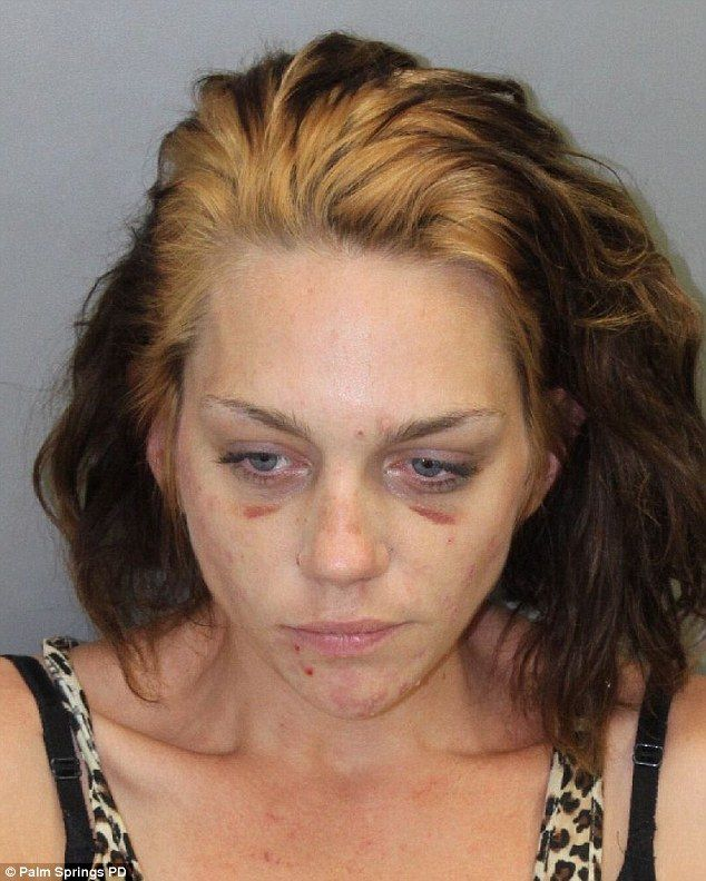 Horrific: Former America's Next Top Model star Renee Alway has a battered and bruised face in a mug-shot that was released on Wednesday
