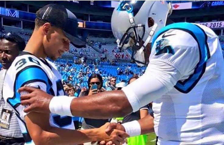 Things the media doesn't show.  Cam Newton and Steph Curry praying before the game