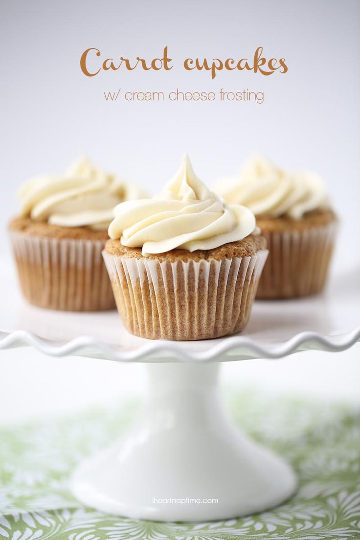Super rich, soft and delicious carrot cupcakes topped with cream cheese frosting! Recipe found on iheartnaptime.com
