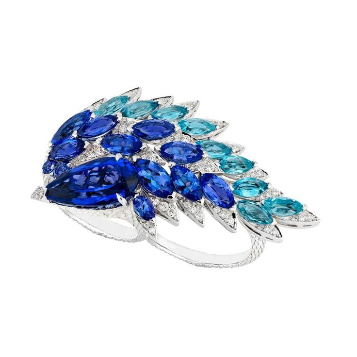 Marquise-cut aquamarines and tanzanite cover this Magnipheasant two-finger ring by Stephen Webster   www.thejewelleryeditor.com