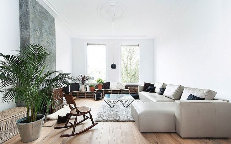 Scandinavian style living room of Dutch apartment in white