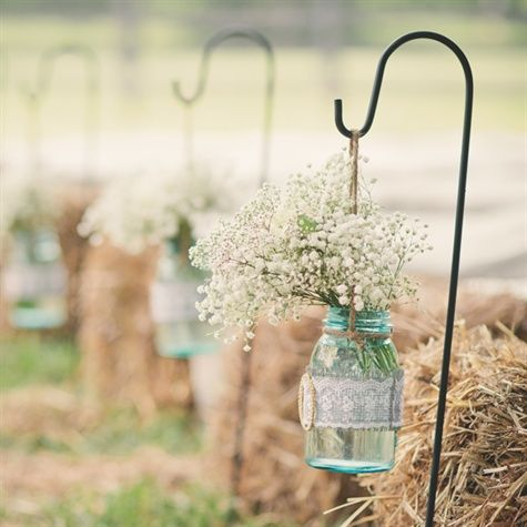 antique Ball jars, wrapped in lace and grey burlap with a gold and diamond buckle.