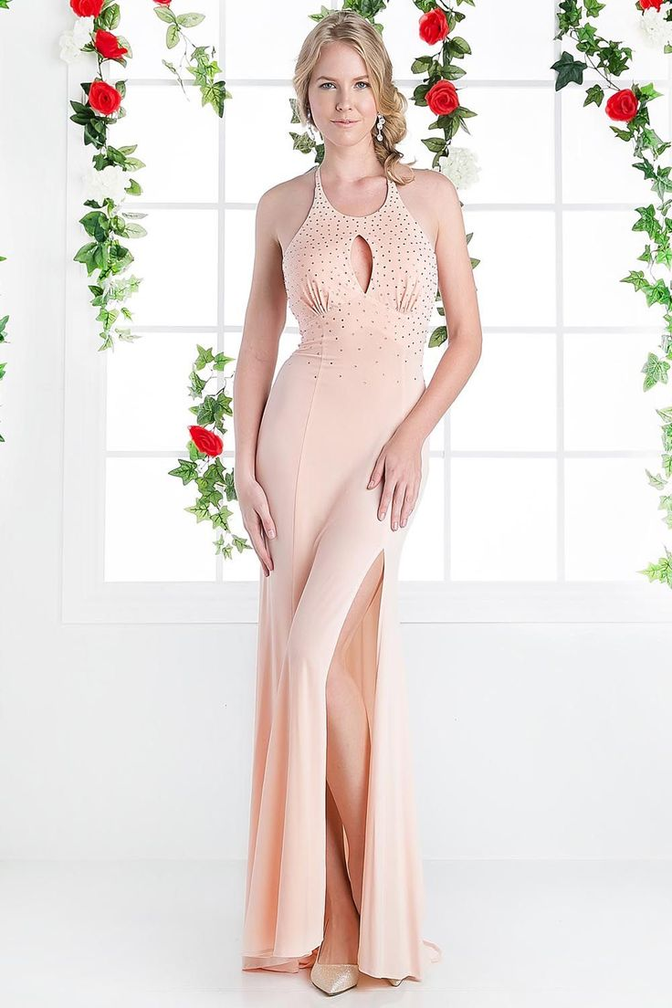 BG2700c.This floor length, sleeveless, high neck, open back dress is on trend. With it's understated beading and thigh high slit it ticks all the boxes!