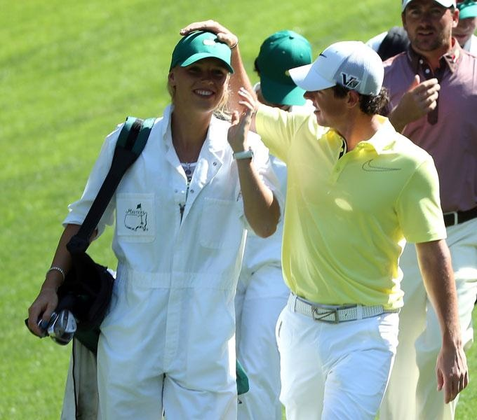 Rory McIlroy had his girlfriend-turned-caddie, Caroline Wozniacki, on the bag Wednesday. The former world No. 1 womens tennis player took a turn at golf on No. 9, but she dribbled the ball straight into the water.