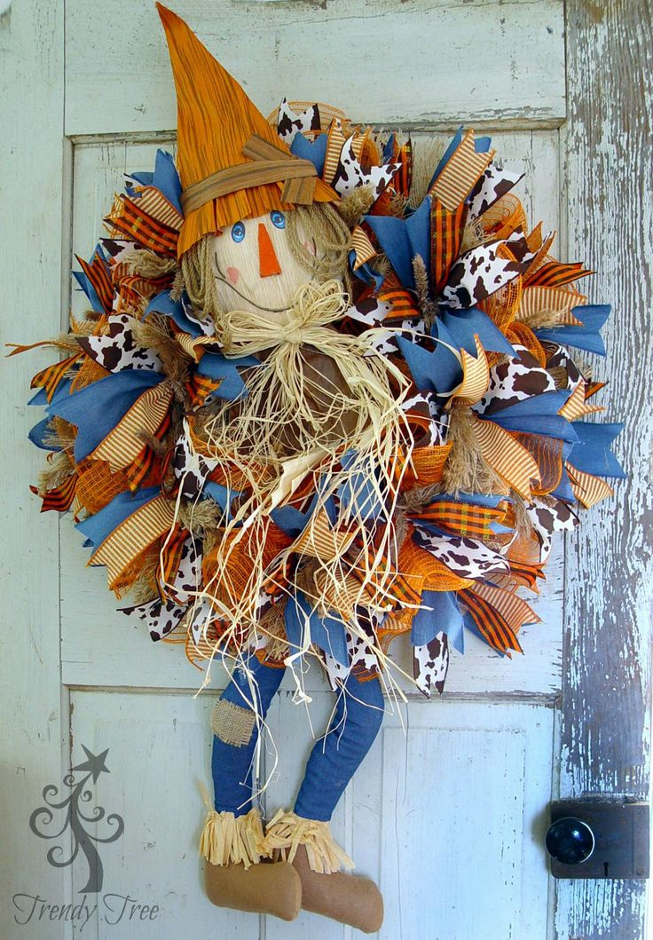 DIY Scarecrow wreath with legs, tutorial by Trendy Tree using frayed edge burlap mesh, ribbons, work wreath, scarecrow head and legs.
