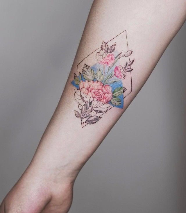 Gorgeous geometric and flower tattoo.