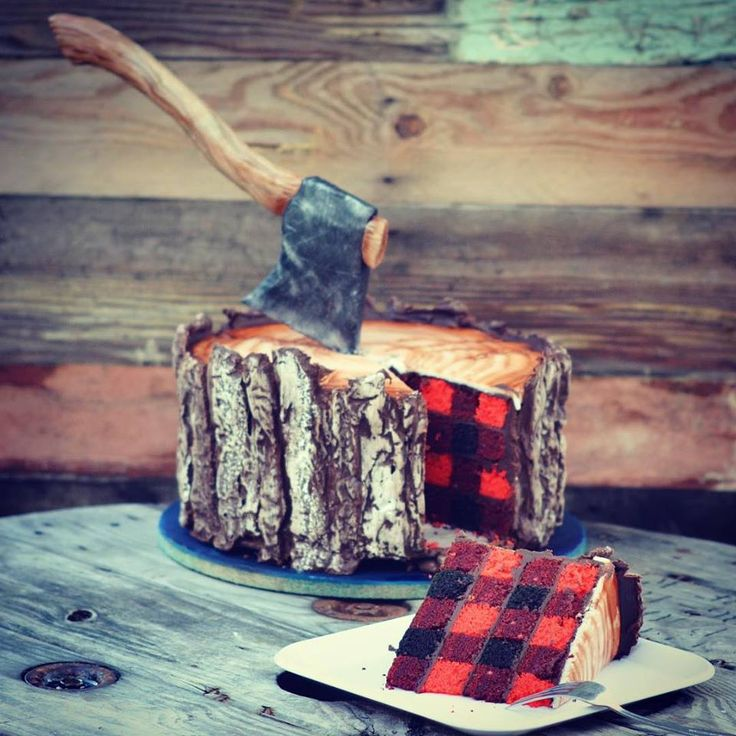 So great. A plaid-inside cake in shades of red is covered in wood grain and bark texture. Oh and a sugar axe!