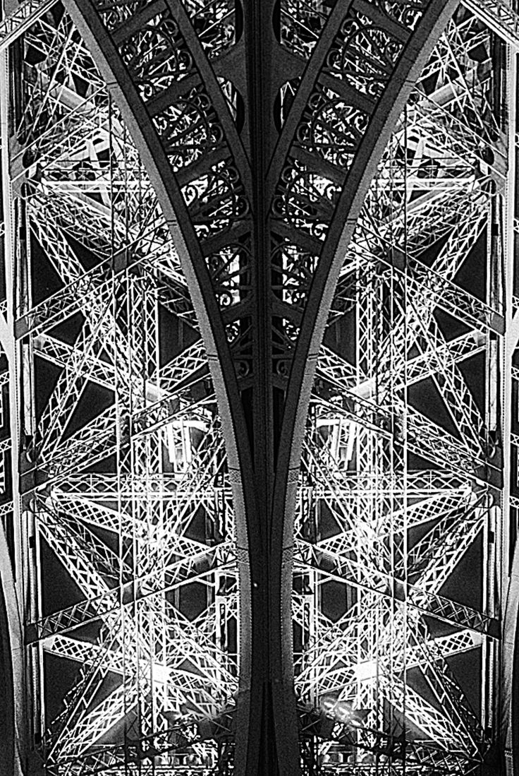 Paris's Eiffel Tower is often illuminated dramatically at night.  This long-exposure photograph was made half-way up the tower with my favorite Nikon FM2 Camera, Kodak Plus X film and Nikkor 55mm Macro lens.  Fortunately I had a tripod with me; I hadn't expected to find anything like this.  The exposure was 85 seconds with an aperture setting of f22.