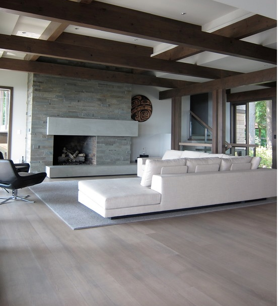 White washed wood floors with white walls and dark ceiling.