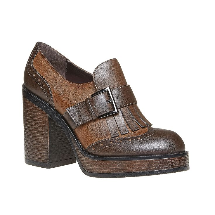 Scarpe basse da donna in stile Kiltie Oxford decorate da frange sul collo del piede e un cinturino con fibbia appariscente. Il tacco massiccio è integrato da un plateau e all'interno è presente una soletta in pelle. La decorazione Brogue e la combinazione di due tonalità di marrone rendono il modello ancora più affascinante. Queste calzature possono ravvivare l'outfit semplice.