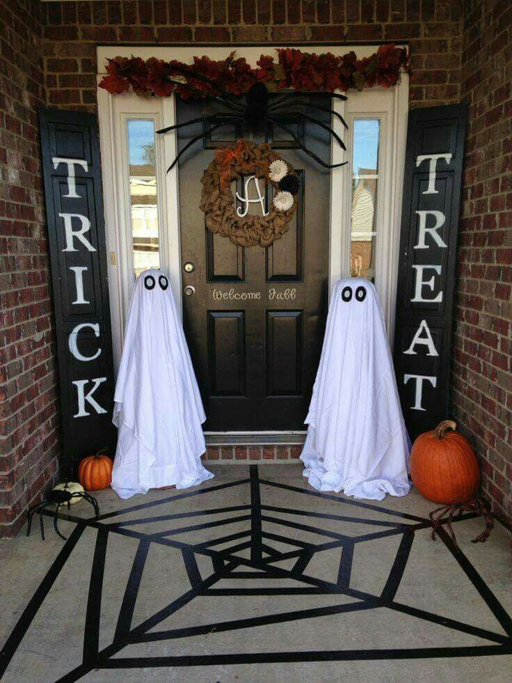 the chic technique halloween porch painted bifold doors black painters tape for the web and - Creative Halloween Door Decorations