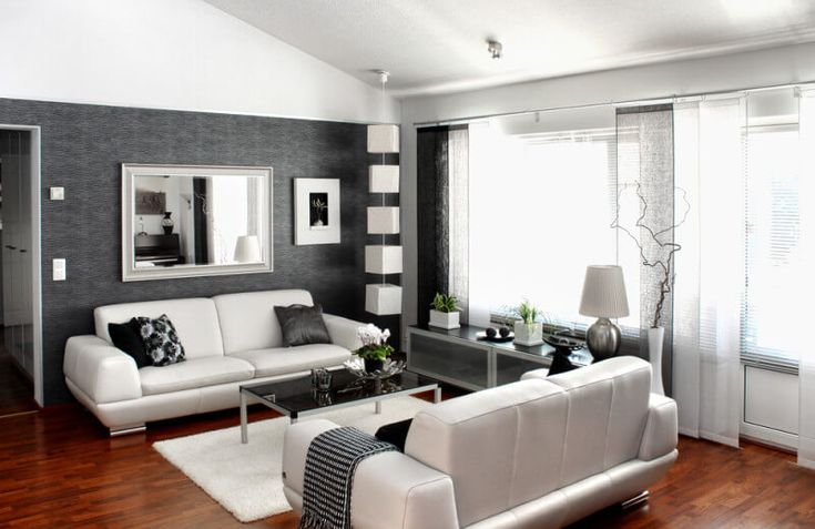 This space is accented by a classic palette of black and white.  It features chrome accents and warm, cherry wood flooring.