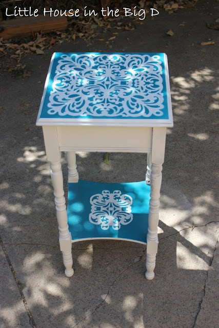 Side table with laser cut scrapbook paper as a stencil - pretty.  (tutorial link)