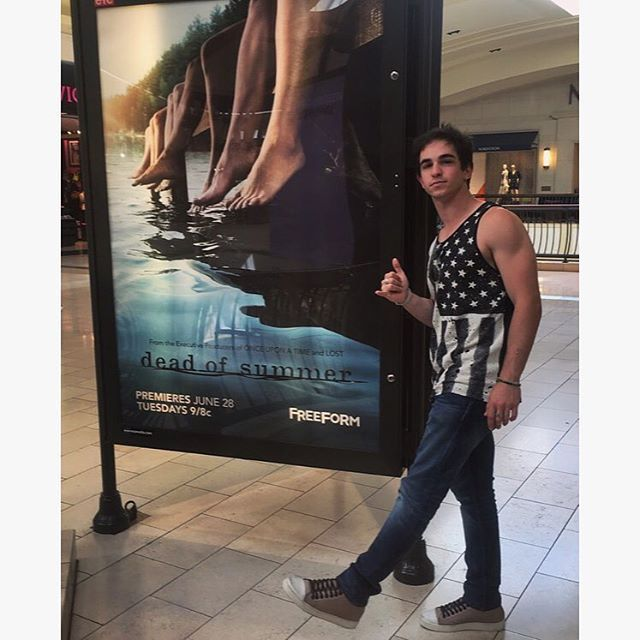 Cutie Zachary Gordon with Dead of Summer poster