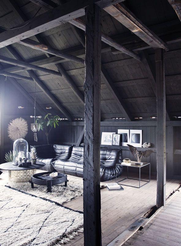 The livingroom loft at the Milla-farm in Aurskog. Home of interior stylist Camilla Berntsen. Togo sofa and Beni Ourain rugs. Art by John Andre Hanøy and Mathieu Miljavac.