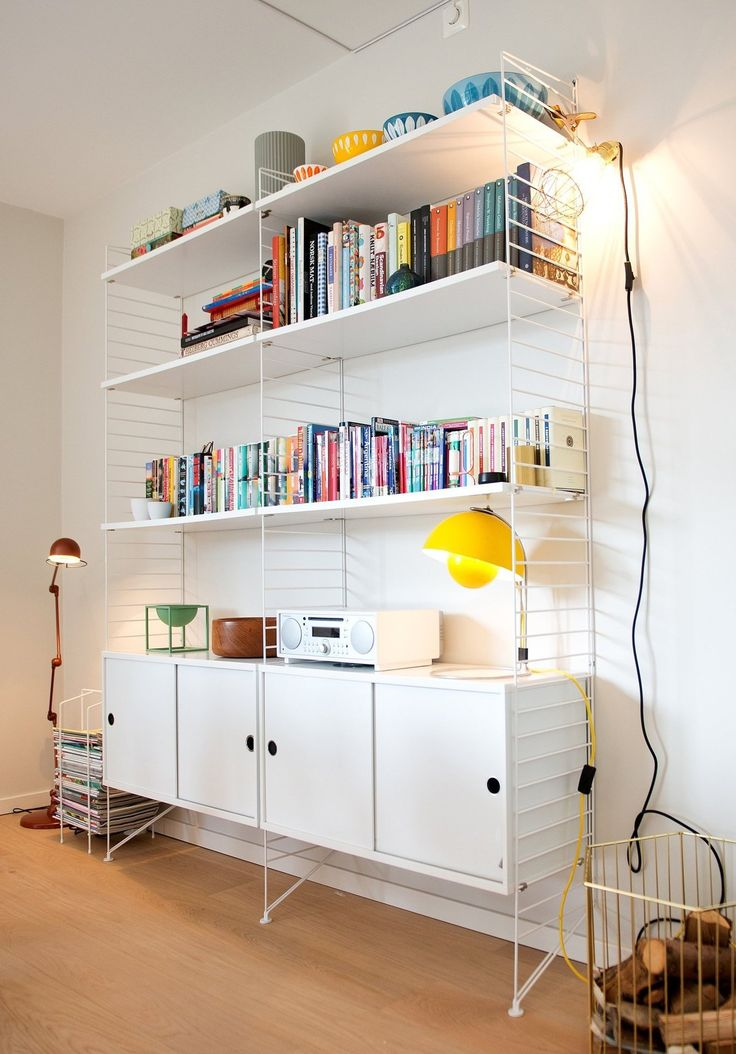 Edith's Clean & Colorful Oslo Townhome Remake a IKEA bookshelf. Paint the sportens in colors like the books. Six sacks.
