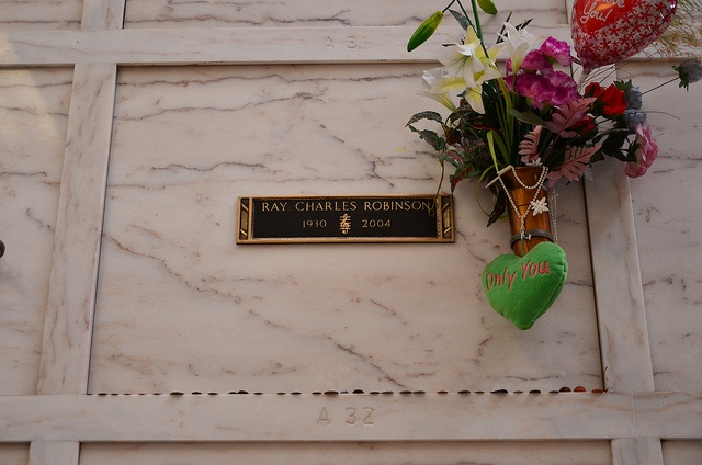 Grave Marker- Ray Charles, Grammy winning crooner who blended gospel and blues. Charles died on June 10, 2004, at 11:35 a.m. due to liver failure/hepatitis C at his home in Beverly Hills, California, surrounded by family and friends. His body was interred in the Inglewood Park Cemetery.