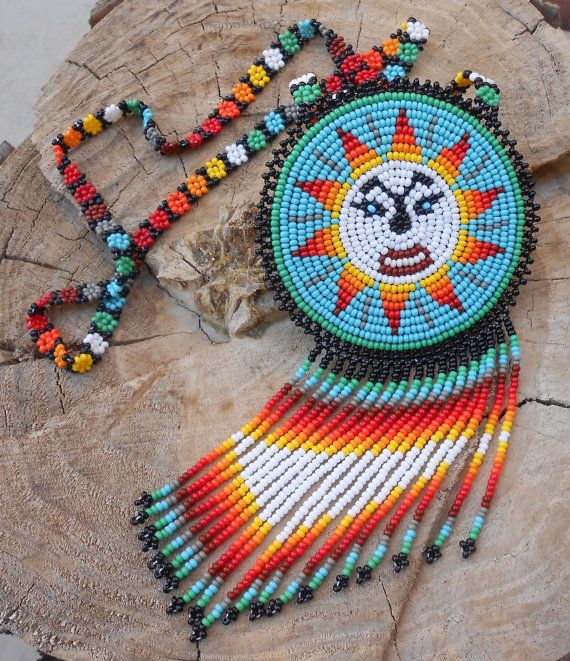 This is a pouch necklace that I handmade using glass seed beads designed with a star which symbolizes Life Power. The combined colors all together are Green, Baby Blue, Brown, Dark Red, Red, Orange, Light Orange, Yellow, Grey, White and Black. Im very pleased about this necklace,