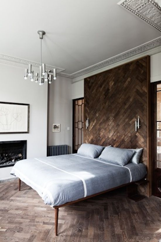 Whilst also adding a striking contemporary feature, the parquetry panel continues the conversation between the individual C20th furnishings, and the elegant period cornicing.